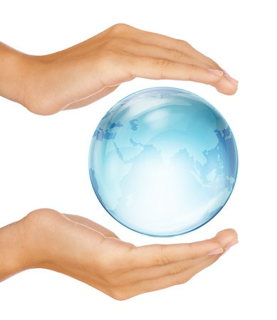 Saving the earth concept: Human hands surrounding the globe isolated on white background