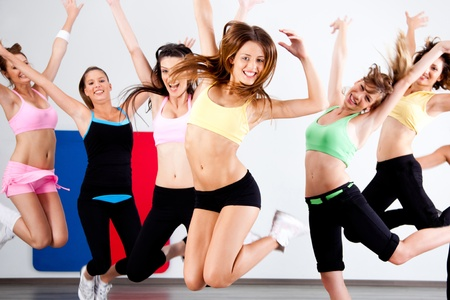 Enthusiastic group of women having fun during aerobics class.