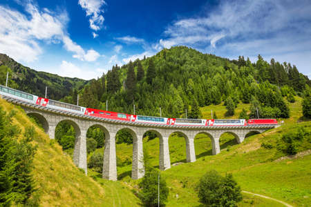 Train on famous landwasser Viaduct bridge.The Rhaetian Railway section from the Albula/Bernina area (the part from Thusis to Tirano, including St Moritz) was added to the list of UNESCO World Heritage Sites, Switzerland, Europe.