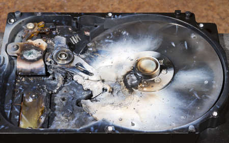 melted hard drive in close up view