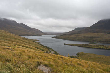 rural landscape in north scotland with lake and wetland