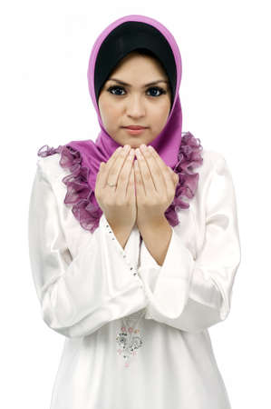 Beautiful young muslim woman pray isolated white background