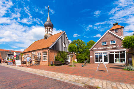 HOOKSIEL, WANGERLAND, GERMANY - JUNE 11, 2017: Hooksiel museum, school, city hall, health resort administration. Copy space for text