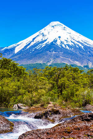 Petrohue waterfalls and volcan Osorno in national park Vicente Perez Rosales, Chile. Vertical