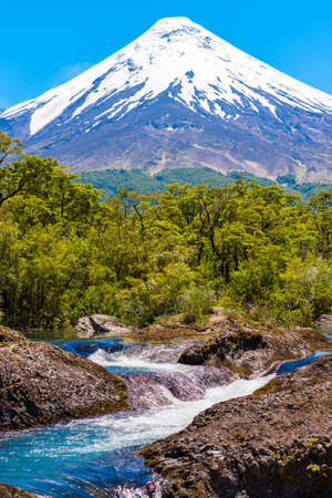 Petrohue waterfalls and volcan Osorno in national park Vicente Perez Rosales, Patagonia, Chile. Vertical