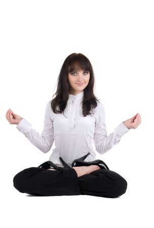 beautiful businesswoman exercising yoga . Isolated over white background .
