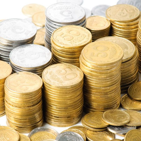 Stacks of coins . isolated on white background .
