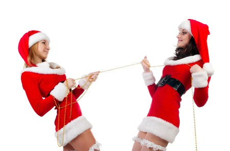 Two sexual girls in Christmas clothes . Isolated over white background .