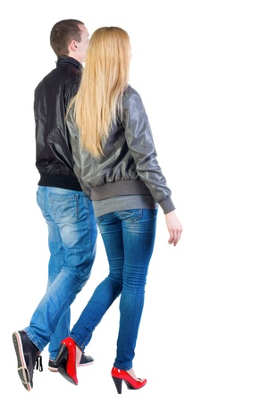 Back view of going young couple (man and woman) . walking beautiful friendly girl and guy in jacket and jeans together. Rear view people collection.  backside view of person.  Isolated over white background.の写真素材