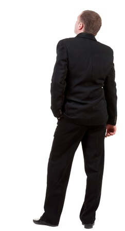 back view of Businessman looks ahead. Young guy in black suit  watching. Isolated over white background. Rear view people collection. backside view of person.