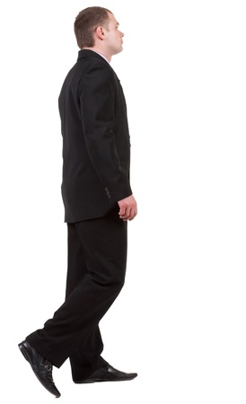 back view of going business man. walking young guy in black suit. Isolated over white background. Rear view people collection.  backside view of person.