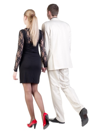 Back view of going young business couple (man and woman) . walking beautiful friendly girl in dress and guy in suit. Rear view people collection.  backside view of person.  Isolated over white background.の写真素材