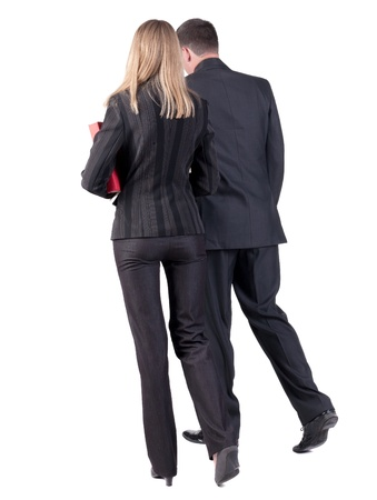 Back view of walking business team  Going young couple  man and woman  with books  beautiful friendly girl and guy in suit go get an education  Rear view people collection  backside view of person  Isolated over white backgroundの写真素材