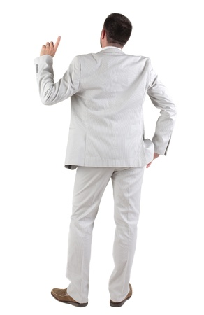 Back view of  thinking young business man in  white suit. Rear view. isolated over white background. Concept of idea, ask question, think up, choose, decide.の写真素材