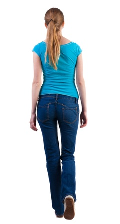 back view of walking  woman  in   jeans and shirt. beautiful blonde girl in motion.  backside view of person.  Rear view people collection. Isolated over white background.の写真素材
