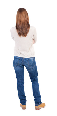 back view of standing young beautiful  woman in jeans. girl  watching. Rear view people collection.  backside view of person.  Isolated over white background.の写真素材