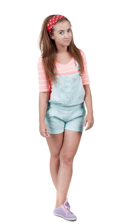 Photo for Red-haired teen girl in shorts. isolated on white background - Royalty Free Image