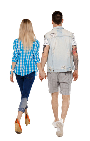 Photo pour Back view of going couple. walking friendly girl and guy holding hands. Rear view people collection. backside view of person. Isolated over white background. The guy and the girl go hand in hand. - image libre de droit