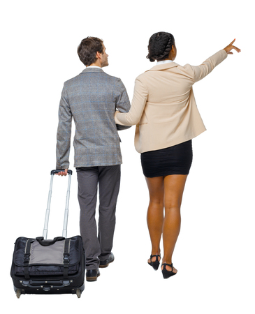 Photo pour Back view of pointing interracial going couple with suitcase. Rear view people collection. backside view of person. Isolated over white background. Husband and wife on a trip looking at the sights. - image libre de droit