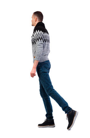 Photo pour Side view of going  handsome man in winter sweater. walking young guy . Rear view people collection.  backside view of person.  Isolated over white background. A guy in a warm gray sweater is slowly walking sideways. - image libre de droit