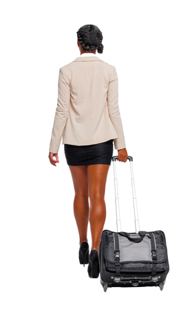 Photo pour Back view of black African-American in formal attire walking with a suitcase. business woman in motion.  backside view of person.  Rear view people collection. Isolated over white background. - image libre de droit