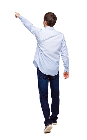 Photo for Back view of a man walking with a pointing hand. going guy showing.  backside view of person.  Rear view people collection. Isolated over white background. The guy in the white shirt walks forward, showing his fingers up. - Royalty Free Image