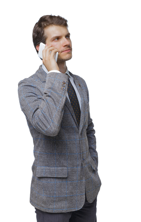Photo pour back view of business man in suit  talking on mobile phone. fromt view people collection. Isolated over white background. Pensive businessman talking on a smartphone. - image libre de droit