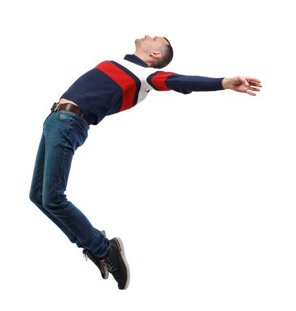 Photo pour Side view of man in zero gravity or a fall. guy is flying, falling or floating in the air. Side view people collection.  side view of person.  Isolated over white background. - image libre de droit