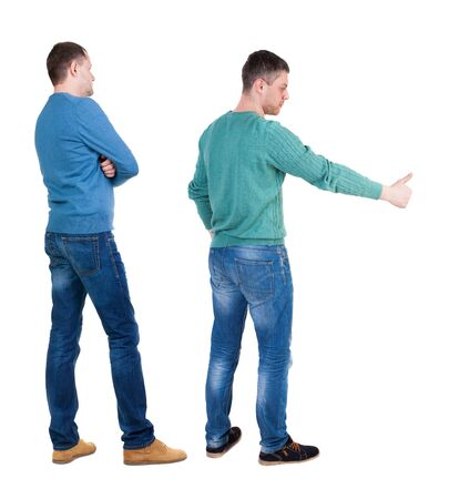 Photo pour Back view two man in sweater showing thumb up. Rear view people collection. backside view of person. Isolated over white background. - image libre de droit