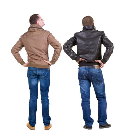 Photo pour Back view of couple in winter jacket. beautiful friendly girl and guy together. Rear view people collection. backside view of person. Isolated over white background. - image libre de droit