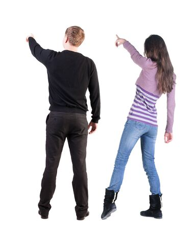 Photo pour Back view of couple in sweater pointing. Rear view people collection. backside view of person. Isolated over white background. - image libre de droit