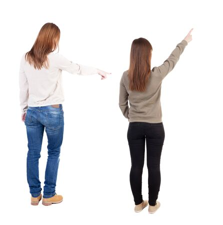 Photo pour Back view of two pointing girl in sweater. Rear view people collection. backside view of person. beautiful woman showing gesture. Rear view. Isolated over white background. - image libre de droit