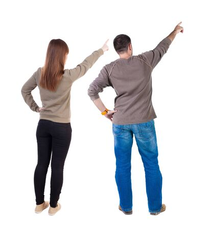 Photo pour Back view of couple in sweater with mobile phone. beautiful friendly girl and guy together. Rear view people collection. backside view of person. Isolated over white background. - image libre de droit