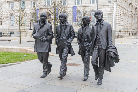 Bronze statues of the Beatles in Liverpool Waterfront, England
