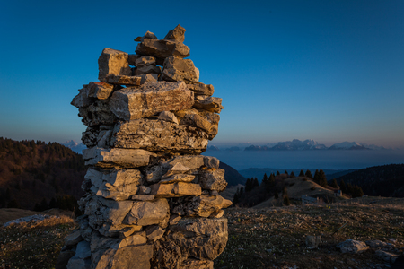 Cumulation of stones on the top of a mountain, with the Dolomite peaks  in the background, Pian de le Femene, Veneto, Italy