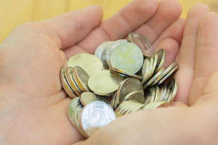 Photo pour Coins in the hand of a man. Concept of making money - business and so on. - image libre de droit