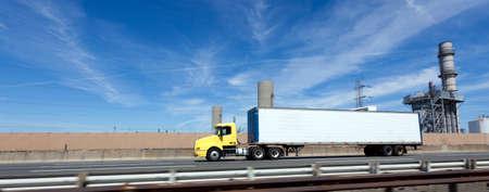 Foto für Yellow cab semi with white trailer on interstate under blue sky. Horizontal. - Lizenzfreies Bild