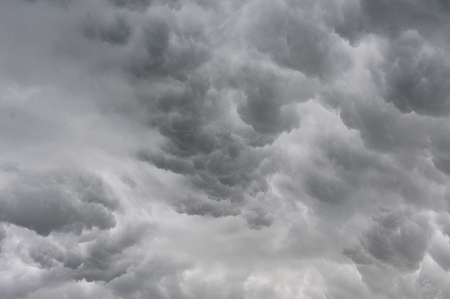 Background of storm clouds before a thunder-stormの写真素材