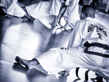 master trains his students. Training of Taekwon-do for kids