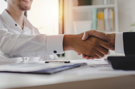 Photo pour Partnership. two business people shaking hand after business job interview in meeting room at office, congratulation, investor, success, interview, partnership, teamwork, financial, connection concept - image libre de droit