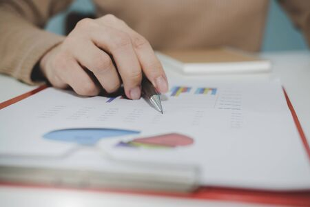 Photo for business woman working and calculating about finance with strategy graph chart, document report and notebook on desk at home, work from home, digital online marketing and financial business concept - Royalty Free Image