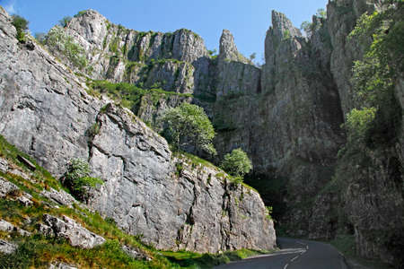 The cliffs of Cheddar Gorge in the Mendip Hills in Somerset, England are limestone and around 500 feet high.