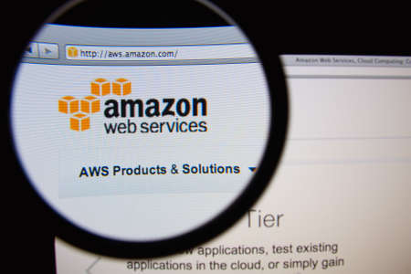 LISBON, PORTUGAL - FEBRUARY 19, 2014: Amazon Web Services homepage through a magnifying glass.