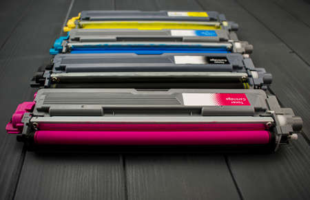 Photo for Cyan, magenta, amariyllo and black color toner rollers of a foreground color laser printer - Royalty Free Image