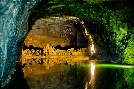 Rock wall reflected in underground lake in Hinterbruhl seegrotte. Lower Austria
