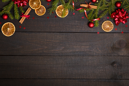 Photo pour Dark rustic wooden table background with Christmas decoration and fir frame. Top view with free space for copy text - image libre de droit
