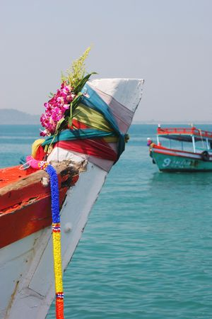 It is Thai tradition to put flowers on a boat for a safe journey - travel and tourism