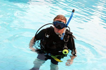 Man in scuba gear in a swimming pool.