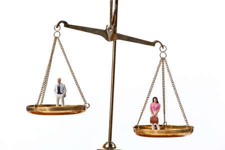 Dolls on balancing scales. Horizontally framed shot.
