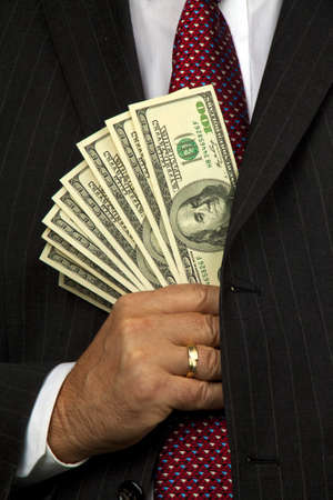 Business man with many dollar bills. Ion of economic crime